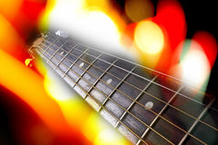 Guitar Background. A musical background of a guitar fretboard in colorful lights Stock Photography