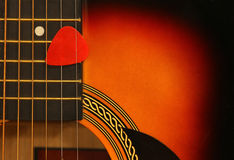 Guitar background with pick Stock Photo
