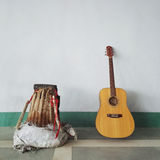 Guitar and basket Royalty Free Stock Photo