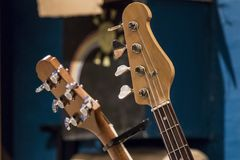 Guitar and bass. Bass Guitart and acoustic guitar in a rack stock photos