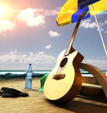 Guitar on the beach. Acoustic guitar near the deck chair under umbrella on the beach at sunset Stock Images