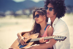 Guitar beach couple Stock Photo