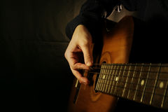 Guitar at black background Royalty Free Stock Images