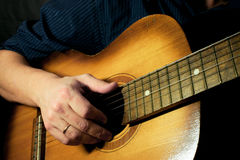 Guitar at black background Stock Photography