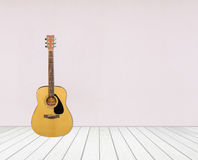 Guitar in blank empty room Stock Photos