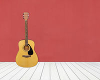 Guitar in blank empty room Royalty Free Stock Image