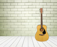 Guitar in blank empty room Stock Photography