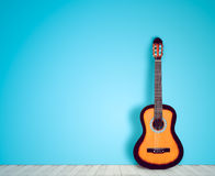 Guitar in blank empty room background. in the style nostalgia Stock Photos