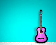 Guitar in blank empty room background. in the style nostalgia Royalty Free Stock Photos