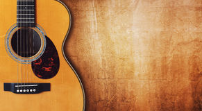 Guitar and blank grunge background stock photo