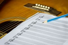 Guitar and blank notebook. Stock Photos