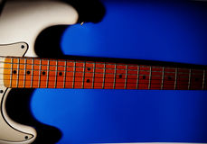 Guitar on blue Royalty Free Stock Images