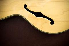 Guitar body detail with sound f-hole Royalty Free Stock Image