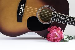 Guitar body with pink flower on right side royalty free stock photos