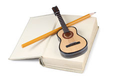 Guitar and book Royalty Free Stock Image