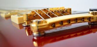 Guitar bridge. A close up of an electric guitar bridge Stock Images