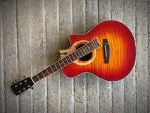 Guitar. Broken guitar on ciment Stock Image