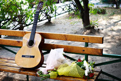Guitar and a bunch of flowers Stock Image