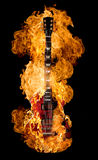 Guitar Burning. Classic electric guitar burning on black background royalty free stock photography