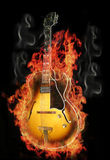 Guitar burning on fire. A burning guitar on fire Royalty Free Stock Photos