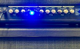 Guitar cable plugged into the amplifier box, professional music equipment royalty free stock images