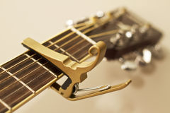 Guitar Capo. An image of a capo for a stringed istrument.  Shallow depth of field.  Focused on the capo Stock Photography