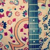 Guitar on carpet Royalty Free Stock Photos