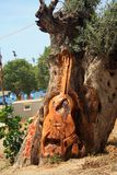 A guitar carved on the tree on the Matala beach on the Crete island stock photography