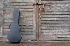 Guitar case. The guitar case rest on a gate stock photos