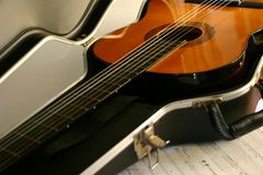 Guitar in Case. Acoustic guitar in hard case with sheet music Stock Photo