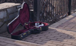 Guitar case of a musician who plays for money Royalty Free Stock Photography