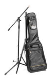 Guitar case and stand for microphone isolated on the white background Stock Image