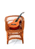 Guitar on a chair ! Stock Photos