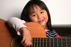 Guitar child Stock Images