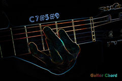 Guitar chord on a dark background Royalty Free Stock Image
