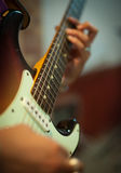 Guitar chords detail with human hands playing Stock Image