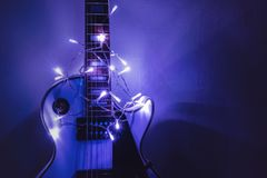 Guitar with decorated Christmas Royalty Free Stock Images