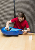 Guitar cleaning Stock Photo