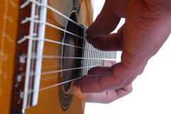 Guitar Close. Close up of a musician playing a guitar Stock Photos