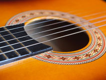 Guitar close-up. Detail of a folk acoustic guitar Royalty Free Stock Image