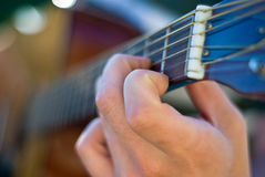 Guitar close up. A close up of a man's hands playing the guitar Stock Photos