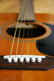Guitar Close Up 2. Close up of an acoustic guitar looking up the bridge Stock Photography