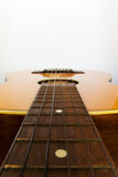 Guitar close up. Guitar positioned horizontal to have space at top of image for designers Royalty Free Stock Photo