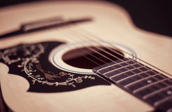 Guitar. Close-up guitar body with sound hole and strings Stock Photo
