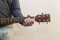 Guitar close-up. The guy playing the guitar. The hand on the strings. Close-up Royalty Free Stock Images