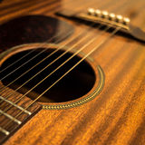 Guitar Close Up. A close up of a mahogany bodied guitar Royalty Free Stock Photos