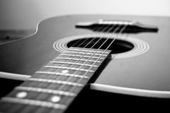 Guitar. Closeup of a black steel stringed acoustic guitar Stock Images