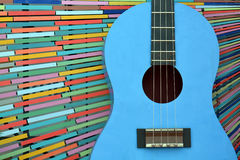 Guitar on colorfully background. Shows music and be used as symbol of people activity Royalty Free Stock Images