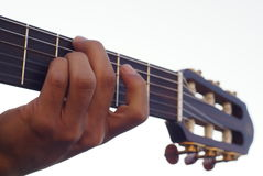Guitar cord. A man's hand playing guitar Royalty Free Stock Photography