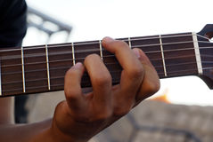 Guitar cord. A man's hand playing guitar. Patch cord Royalty Free Stock Photos